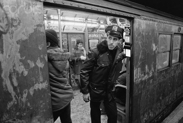 Police Officer Riding Subway Train