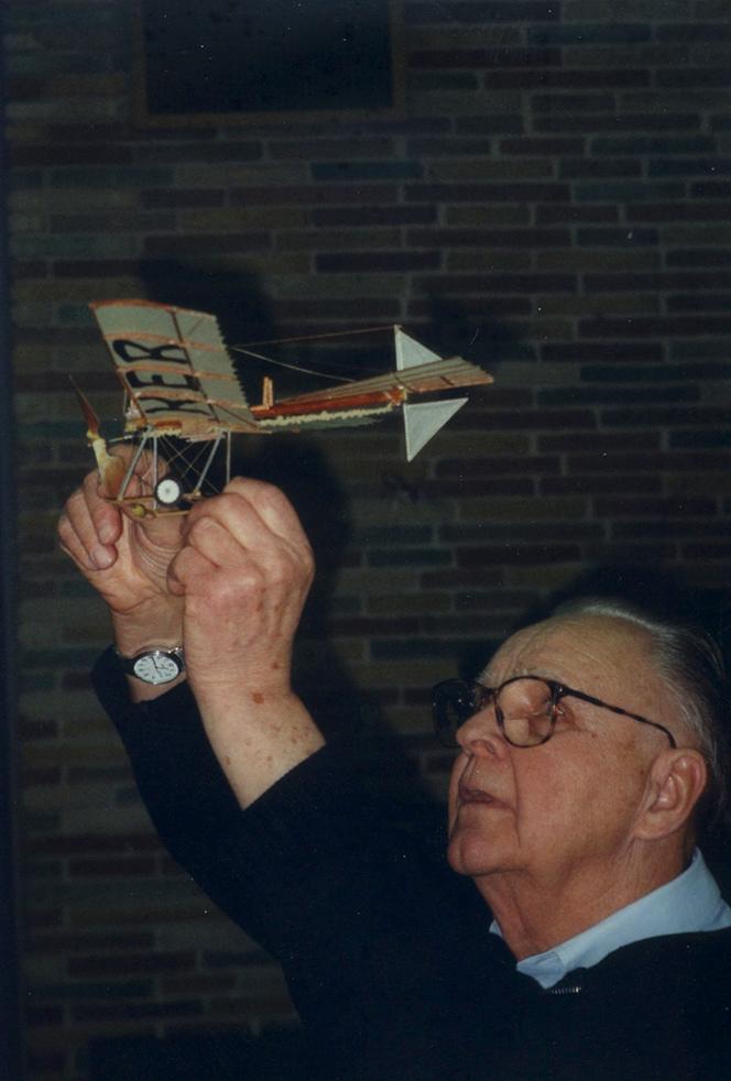 Bob holding plane up