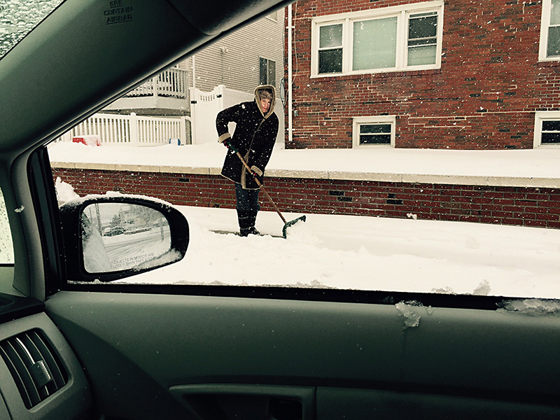 Neighbor shovels snow FullSizeRender