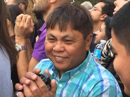 Asian man w camera IMG_3771